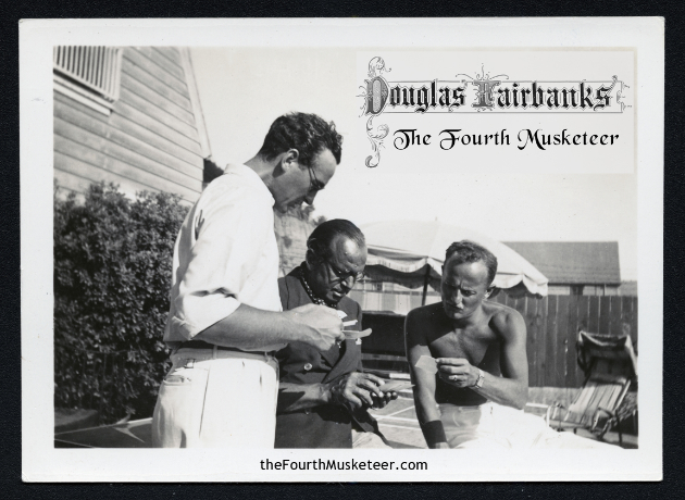 This 1935 photo, taken at Fairbanks' Santa Monica beach house with David Niven (l) and Darryl Zannuck (r) shows the influence Fairbanks wielded within the entertainment industry, after his retirement from active film making in 1932. Fairbanks was sought out by the younger generation of filmmakers, eager to hear what Fairbanks would suggest, in his characteristic generosity of freely sharing his expertise, for the betterment of all.